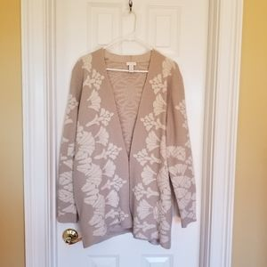 A beige cardigan with embroidery.